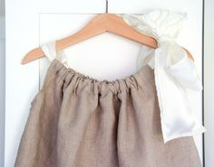 diy flower girl dress pillowcase 2...really big ribbon and think it is only one length for the big shoulder bow.  sweet & elegant look.