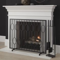 Shop Links Black Fireplace Screen.  Updating a vintage staircase design, this handcrafted iron fireplace screen adds a modern, graphic touch to the room.