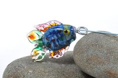 Items similar to Glass multi-coloured fish necklace on Etsy Light Reflection, Colorful Fish, Clear Glass, Sterling Silver Rings, Arts And Crafts, Shapes, Crystals, Etsy, Comet Goldfish