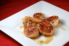 Pan seared scallops in white wine sauce.     Can't wait to try this