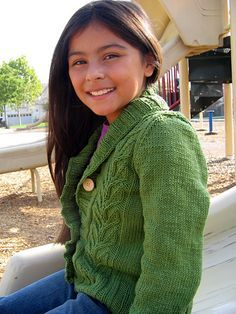 Starsky Junior - Child's 4/6[8/10, 12/14] (shown in size 8/10) [c] sweater is worked with columns of leafy plants and has a ribbed shawl collar