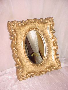 Vintage Wall Decor Ornate Gold tone Mirror 7 by 8 inch Plastic Faux Carved Wood