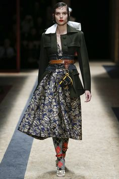 Prada Fall 2016 Ready-to-Wear: This needs a #fearlessfashionredo. I love the green jacket and full skirt. I don't know what the white flap is, and obviously the socks and shoes are vile.