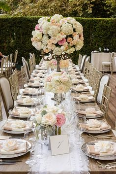 A huge mixed bouquet of romantic pastel an ivory flowers decorates the center of this table. Wedding Table Centerpieces, Reception Decorations, Flower Decorations, Centrepieces, Garden Wedding, Summer Wedding, Dream Wedding, Daytime Wedding, Black Tie Wedding
