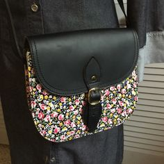 """Stella Rittwagen Floral Crossbody """"Bandolera"""" Adorable Stella Rittwagen Bandolera floral and black leather crossbody.  Stella Rittwagen is a designer from Spain and her bags have been compare to Coach.  Her purses are sold all over the world and are especially sought after in Latin America and Europe.  Here is your change to own one without having to go to Spain!  This bag is in new condition and ready for Spring and Summer. Stella Rittwagen Bags Crossbody Bags"""