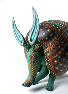 Oaxacan Woodcarvings Jacobo Angeles Armadillo  Oaxacan Wood Carvings are a magnificent expression of Mexican Folk Art. The talented carvers of Oaxaca create,  entirely by hand, wonderful sculptures made  from copal wood and their ingenious shapes with  amazing patterns and colors have captivated collectors world wide. Alebrijes, can also refer to papier mache creatures. Check out the Linares family to learn more.