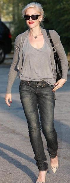 Who made Gwen Stefani's jeans, sweater, black purse and python pumps that she wore in Beverly Hills on April 9, 2010? Shoes – Christian Louboutin  Purse – L.A.M.B.  Jeans – G Star  Sweater – All Saints Tower Cropped Cardigan