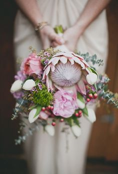 Brides.com: . A modern bouquet comprised of protea, garden roses, tulips, and… #aromabotanical