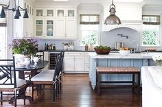 Love this kitchen!!!  Love the bench with a pop of color at the island...