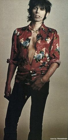 Ahead of the curve, by 40 years. Keith Richards in some floral genius shit.
