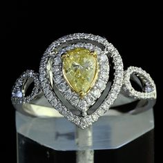 0.83 tcw Fancy Yellow Pear Shape Diamond Engagement Ring in 18K Gold #DiamondsByAl #SolitairewithAccents