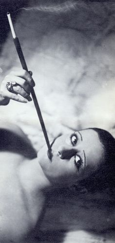 Smoking flapper Lydia Johnson, music-hall singer & dancer. This Columbine lookalike strikes a come-hither look, but her cigarette holder warns of the dangers of coming too close. 1920's Paris. By Jacques-Henri Lartigue. Les Femmes Aux Cigarettes (S'il vous plaît suivre minkshmink sur pinterest) #smoking #smokingflapper #flapper #womensmoking #twenties #paris #cigaretteholder