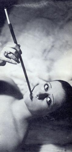 Smoking flapper Lydia Johnson, music-hall singer & dancer. 1920's Paris. By Jacques-Henri Lartigue. Les Femmes Aux Cigarettes.