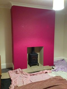 Plum feature wall and log burner