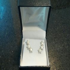 Sterling silver star earrings Celestial sterling silver stars set with tiny sparkling cz's. Stamped 925, includes box. sigal Jewelry Earrings