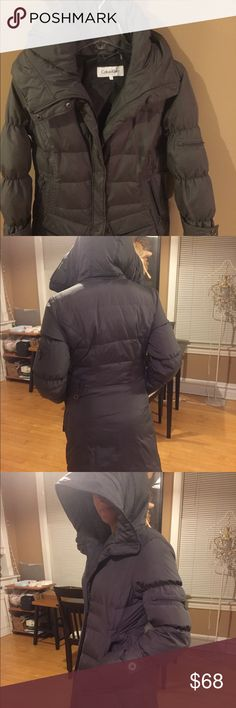 Calvin Klein Puffer coat Calvin Klein Puffer coat in gray. 40% down fill. Machine wash cold. In mint condition. Hardly worn. Calvin Klein Jackets & Coats Puffers