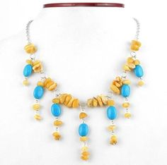 """""""Turquoise & Butterscotch Amber Necklace Item No. AM02210A01 $62.99 This natural Baltic amber nuggets necklace presents striking combination of lovely blue turquoise against warm, butterscotch amber. Nuggets are linked to each other by sterling silver link chain with seven freely moving charm-like droplets, cascading down the necklace. It will bring the lightness and gaiety to any outfit. It is believed that Amber is a symbol of eternal life and youth."""" Amber Necklace, Amber Jewelry, Tassel Necklace, Baltic Amber, Crystals And Gemstones, Turquoise Jewelry, Sterling Silver, Chain, Presents"""