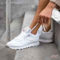 828687644ed All white women s Reebok Classics sneakers. At TheShoeCosmetics all white  trainers are the canvas