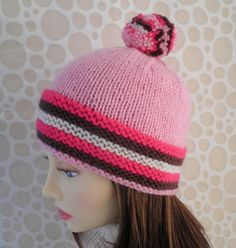KNITTING PATTERN for Striped Ski Hat with POMPOM in 4 Colours - Knit on Straight Needles Please note this listing is for the pattern to knit this hat, not the actual hat itself.  This is my lastest creation for the freezing,snowy, wintry weather which is not far off. It is a bright, funky and fun ski hat in sugar shades of pastel pink, cerise, chocolate and cream, just like delicious nougat. The chunky multicolored pompom adds an extra taste of cheer. The hat pattern is suitable for…