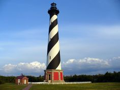 The Cape Hatteras Lighthouse, with its black and white candy-cane stripes, is one of the most famous and recognizable lighthouses in the world. Protecting one of the most treacherous stretches of the Outer Banks, with a beam of light that spans 20 miles into the ocean, the lighthouse is also the world's tallest brick lighthouse at a staggering 208' ft. tall. Located on Hatteras Island in the town of Buxton, North Carolina and is part of the Cape Hatteras National Seashore.