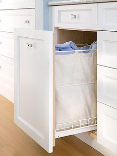 Supposed to be for dirty clothes, like a hidden laundry hamper. I think I would use it for clean towels though. Hidden Laundry, Laundry Storage, Laundry Hamper, Laundry In Bathroom, Bathroom Storage, Laundry Bin, Bathroom Cabinets, Laundry Station, Bathroom Closet