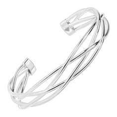 Ribbons of sterling silver are formed in a braided design in this airy cuff, making this piece bold enough to be worn alone and simplistic enough to be stacked with other Silpada favorites! Bracelet measures 6 3/4 inches long and features an easy slip-on design. Made in Italy.