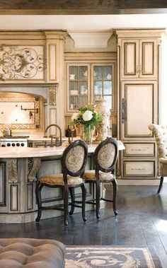 Love the architecture of the kitchen. Probably would pick less ornate chairs-- a little too much going on here