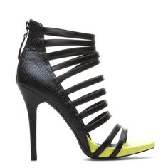 A slim platform and vibrant-hued sole lend this PAPER FOX bootie some eye-catching contrast. Kalista's cutout styling creates a sultry cage effect, with a snake-inspired heel for maximum edge. ShoeDazzle! Style. Personalized.