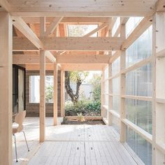 Half of this Japanese residence's unique interior was designed to also look like an exterior space. Contributing both spaciousness and brightness during warmer months, the terrace functions as a glasshouse in winter to keep out plunging temperatures-Design Yoshichika Takagi