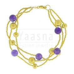 Warm, Stunning, elegant, enchanting, Royal, attractive, charming are the adjectives that comes to mind when you look at this Bracelet, Royal and elegant, Three strings put together with hook in one end. This has a coolness around it and perfect for a glamorous you, This is Gold Dipped and has Amethyst beads. Just wear it and unleash the queen in you  Buy now at http://www.yaasna.com/index.php/bracelets/round-amethyst-and-gold-plated-silver-bracelet.html