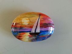 PAINTED STONE...Sailboat at sunset.. Pretty sky colors!