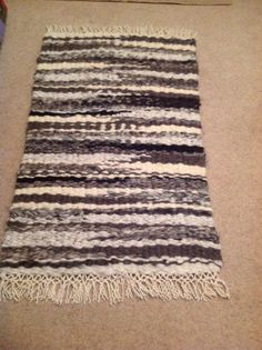 Finished Jacob sheep rug woven on the peg loom