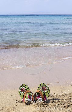 Blue sea and colors beach slippers