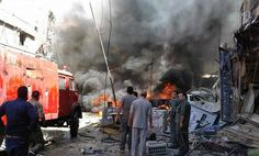 Two suicide bombers struck close to the Syrian capital Saturday, killing at least 12 people and wounding dozens more in the latest attack to hit the predominantly Shiite area in recent months, state TV and an opposition activist group said.