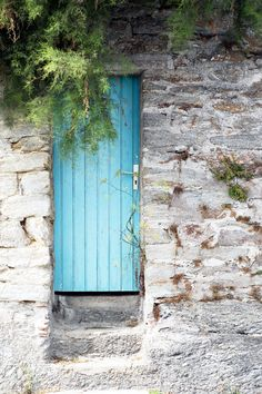 I have always loved the Old World (European) habit of painting doors in bright colors... I bet it makes it easier for others to find your house, too!