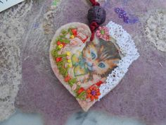 """this little darling heart pendant felted with """"all my heart"""" by my partner-sister Marije- this is a view from the right side (made with an element of her booklet about cats)"""