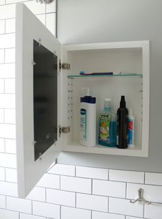 Hidden medicine cabinet, photo frame door