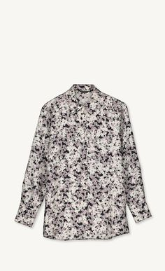 This blouse is made of lightweight silk in the new Henriikka print. It has a straight cut to the hip hemline that's slightly curved and longer in the back. The front closure and cuffs secure with small metal buttons.