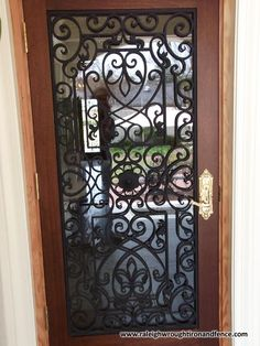 Raleigh Wrought Iron and Fence Co. Custom Wrought Iron Fence in Raleigh NC, Durham, Chapel Hill Wrought Iron Driveway Gates, Iron Accessories, Metal Working, Door Handles, House Design, Chapel Hill, Doors, Durham, Florida