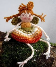 Isn't she adorable! I must might have to make at least one!