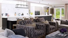 Open-plan Kitchen Living Area with Twin Armchairs and Sofas