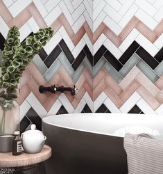 Geometric tiles are a great choice for adding style to your bathroom and we love the combination of. Bad Inspiration, Bathroom Inspiration, Pink Tiles, Colourful Bathroom Tiles, Metro Tiles Bathroom, Chevron Bathroom, Bathroom Wall, Tile Covers, Modern Bathrooms