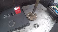 Fitting rear wheel bearings to a side shaft.