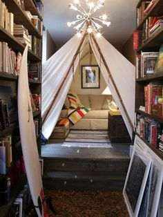 Home Library Ideas - Linen Couch, Photographs, Entryway of Bookshelves, Pendleton Blanket