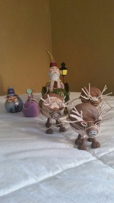 This hand painted gourd Santa with his elf and reindeer set will bring joy to any ones Christmas festivities. the Santa, elf, reindeer, sleigh,