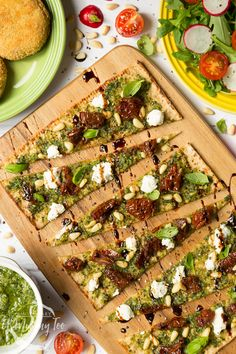 Perfectly chewy flatbread combined with home made pesto and decorated with delicious sun dried tomatoes and goat's cheese for a truly decadent treat. Here's how to make this pesto flatbread pizza. Pesto Pizza, Flatbread Pizza, Cherry Tomatoes, Dried Tomatoes, Cherry Tomato Recipes, How To Make Pesto, Pizza Recipes, Goat Cheese, Vegetable Pizza