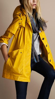 bright yellow raincoat because every lady needs a cute raincoat {even if you only wear it when it's gloomy - at least you look prepared and on trend}
