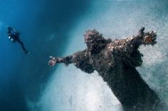 The 38 Most Haunted Abandoned Places on Earth - Christ of the Abyss, San Fruttuoso, Italy   Built by Guido Galletti, this statue of Christ was submerged into water 55 feet deep in 1954.