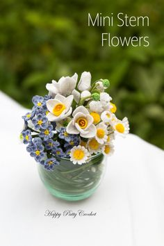 Crochet Mini Stem Flowers patterns by Happy Patty Crochet // Either alone in their own tiny adorable vases or as separate/filler flowers in larger arrangements or bouquets, these small beautiful blossoms are extremely versatile.