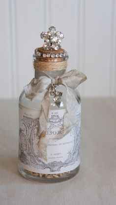 Decorative glass bottle with vintage french label upcycled